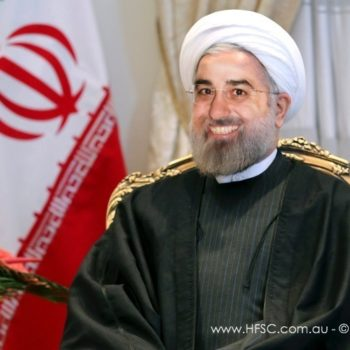 Iran's President Hassan Rouhani at a meeting with Syria's Prime Minister Wael Nader al-Halqi at his office in Tehran, Iran, Sunday, Dec. 1, 2013. Rouhani said his country has widely lobbied for humanitarian efforts aimed at reducing pains of Syrian, according to the presidential website. (AP Photo)